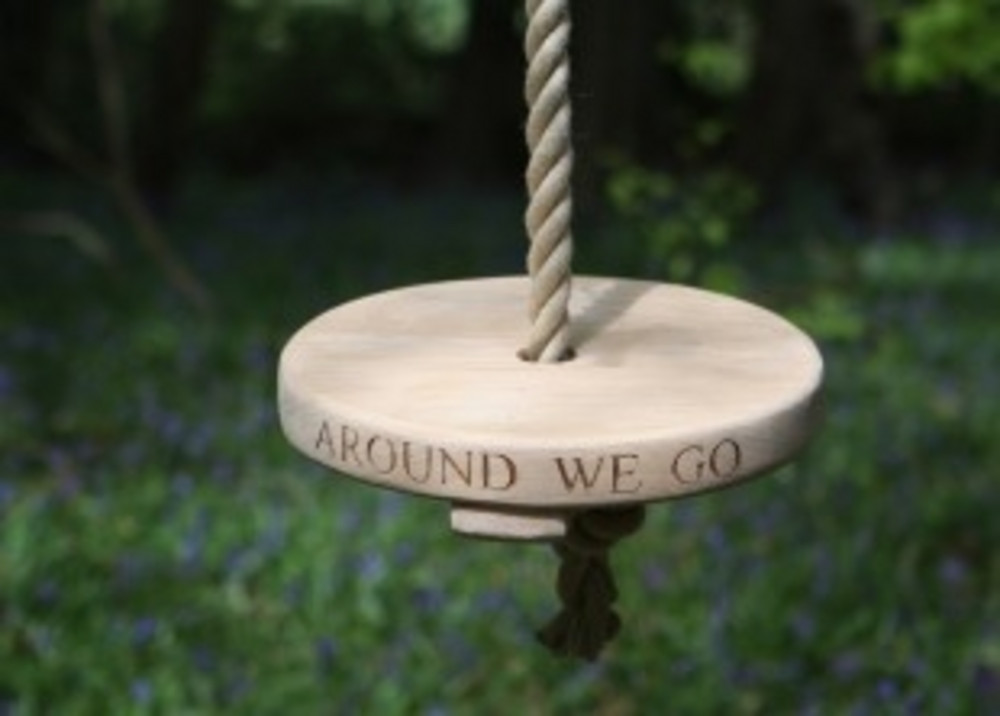 Round Seated Oak Or Chestnut Rope Swings Sitting Spiritually