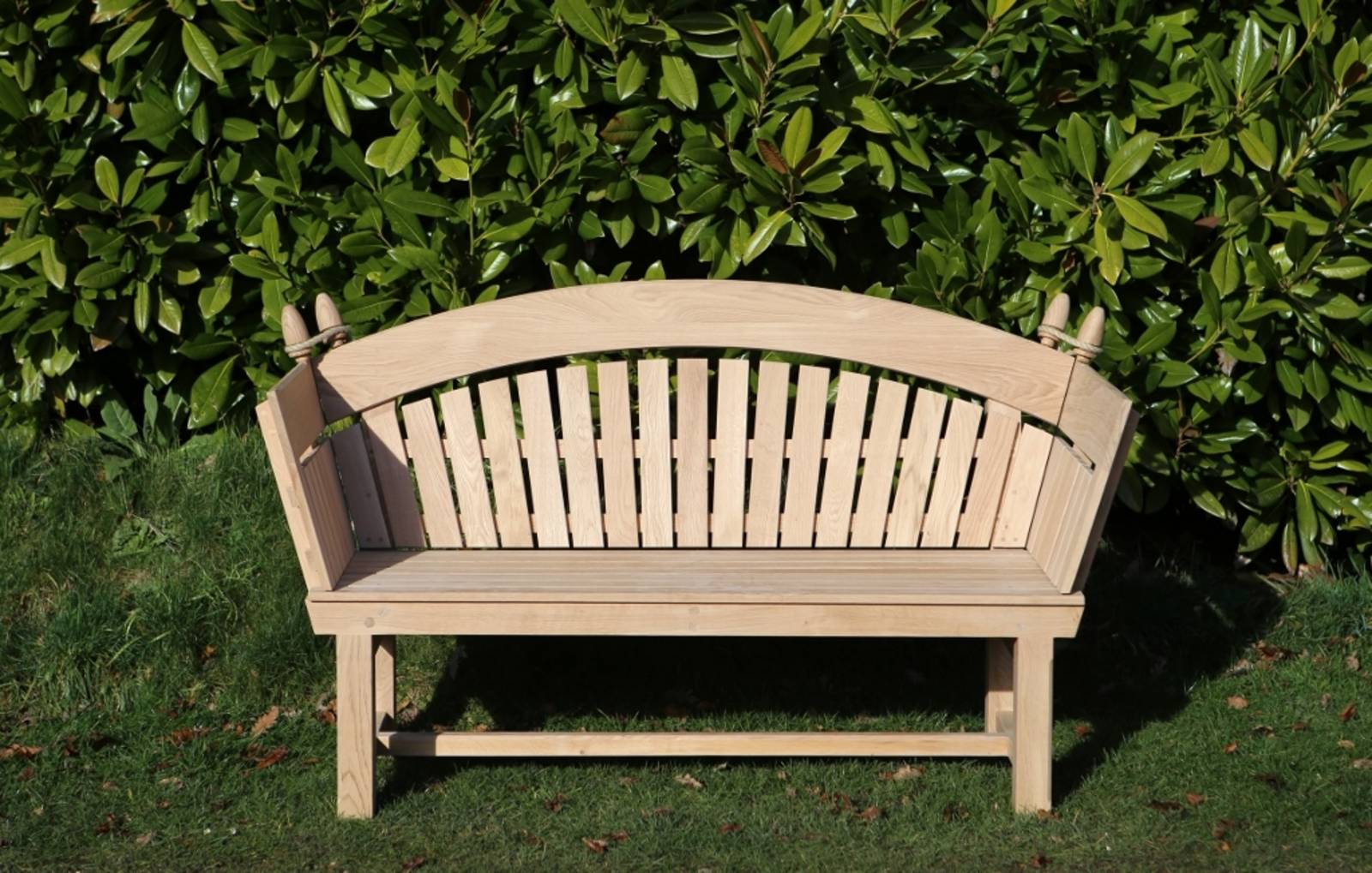 Knole Wooden Garden Bench against Magnolia