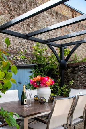 Bespoke Pergola in a garden with seating