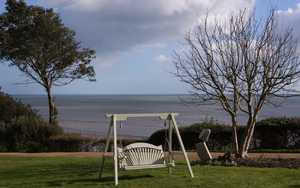 Garden Swing Seat overlooking the sea