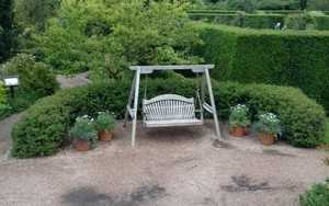 Wooden Swing Seat at RHS Rosemoor Gardens