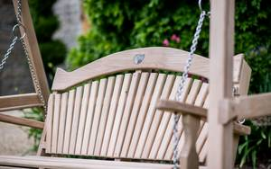 Curved Oak Garden Swing Seat with an ammonite close up