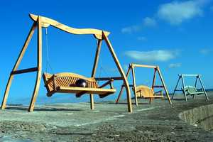 Swing Seats on the Cobb Lyme Regis by Sitting Spiritually - Bespoke Swings For All Ages