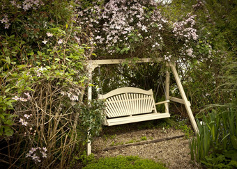 Harmony Swing Seat Surrounded by Clematis