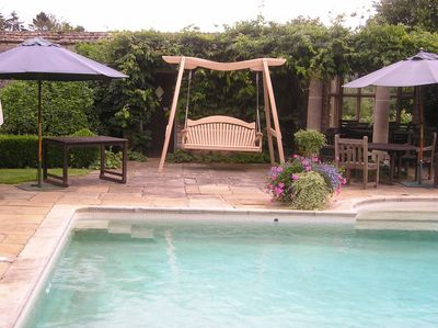Garden Swing Seat By Swimming Pool Kyokusen