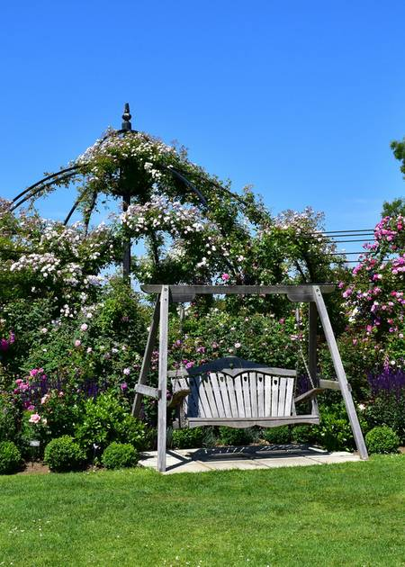 Swing Seat situated in a large garden area
