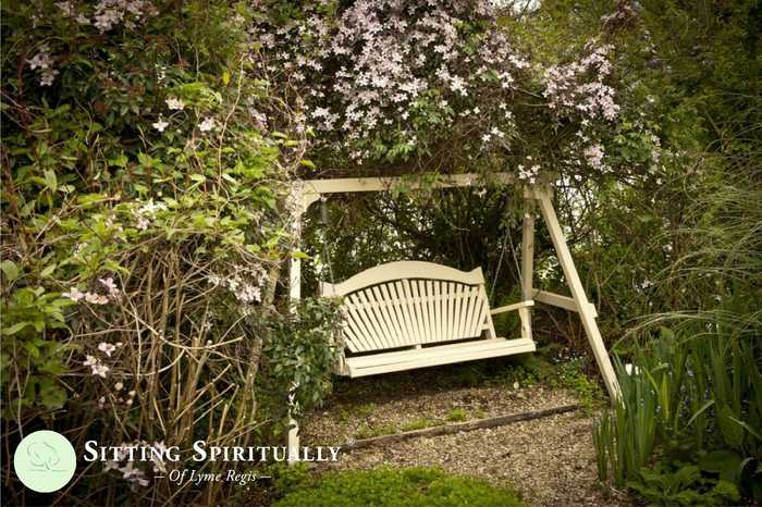 Garden Swing Seat Surrounded by Clematis