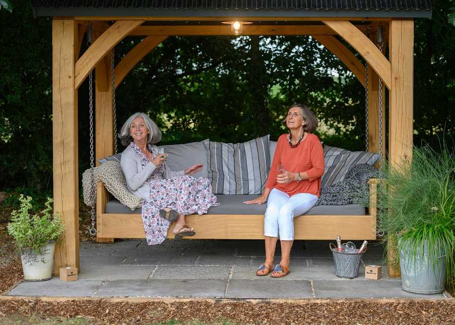 Outdoor Day Bed with Canopy being enjoyed by two people