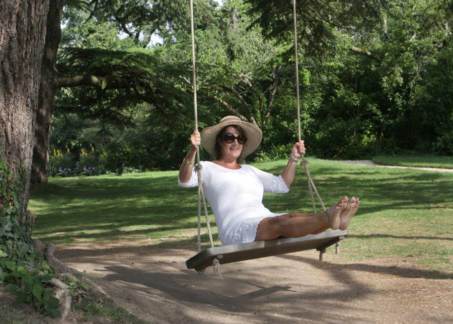 Lady Swinging on a Double Oak Rope Swing