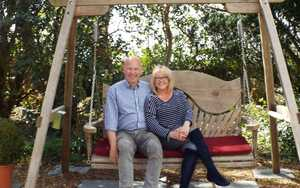 Couple enjoying relaxing on a swing seat at the Dower House Hotel