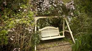 Garden Swing Seat amongst the Clematis