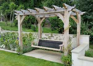 Modern Garden Swing Seat Being Hung from Pergola