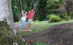 Two Seater Oak Rope Swing being enjoyed