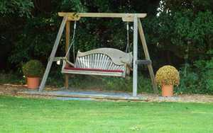 Wooden Swing Seat at The Dower House Hotel